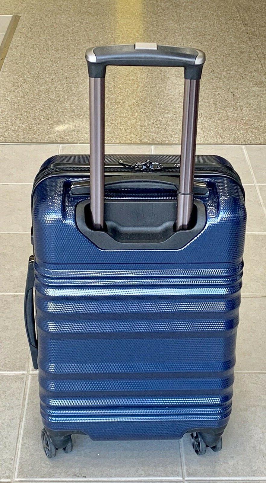 """Traveler's 21"""" carry on hardcase travel spinner"""